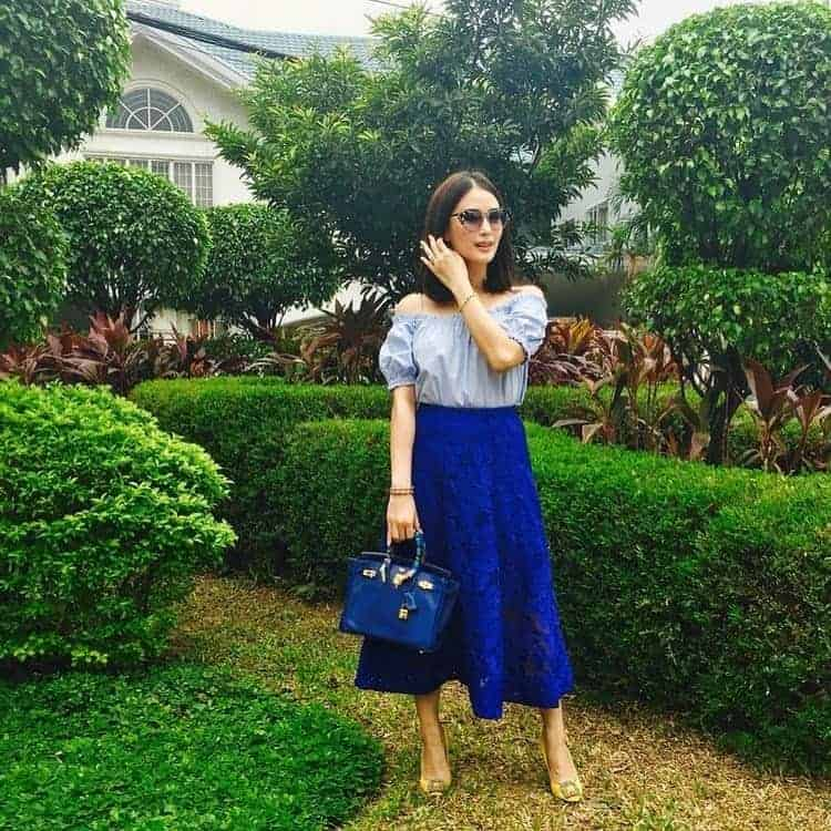 Heart Evangelista in a blue off-shoulder top and calf-length circle midi