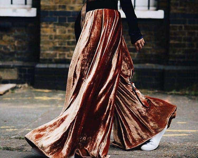 Liz Uy wearing a velvet top and pleated velvet pants