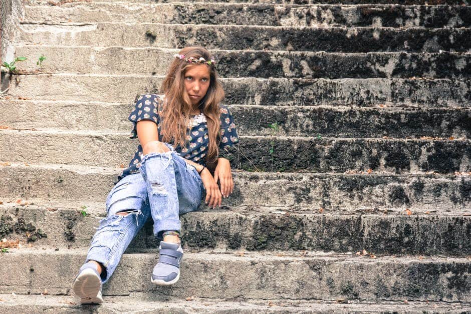 girl on steps in jeans