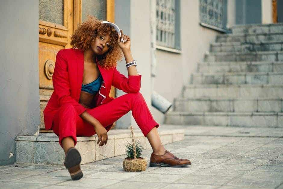 Woman in red suit and oxford shoes