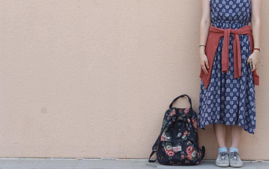 midi dress, sneakers, backpack
