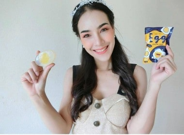 Girl smiling and holding Egg Crystal Soap