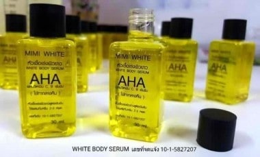 Open bottles of Mimi White Aha Mini Serum