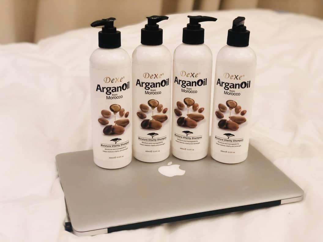 Four Dexe Argan Oil Bottles on a laptop