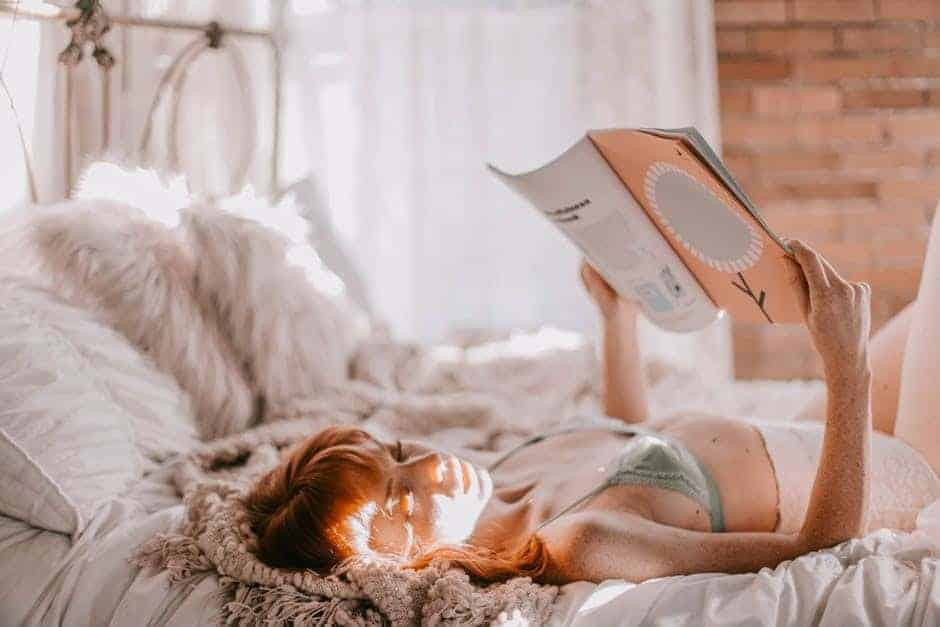 Girl in underwear reading a magazine